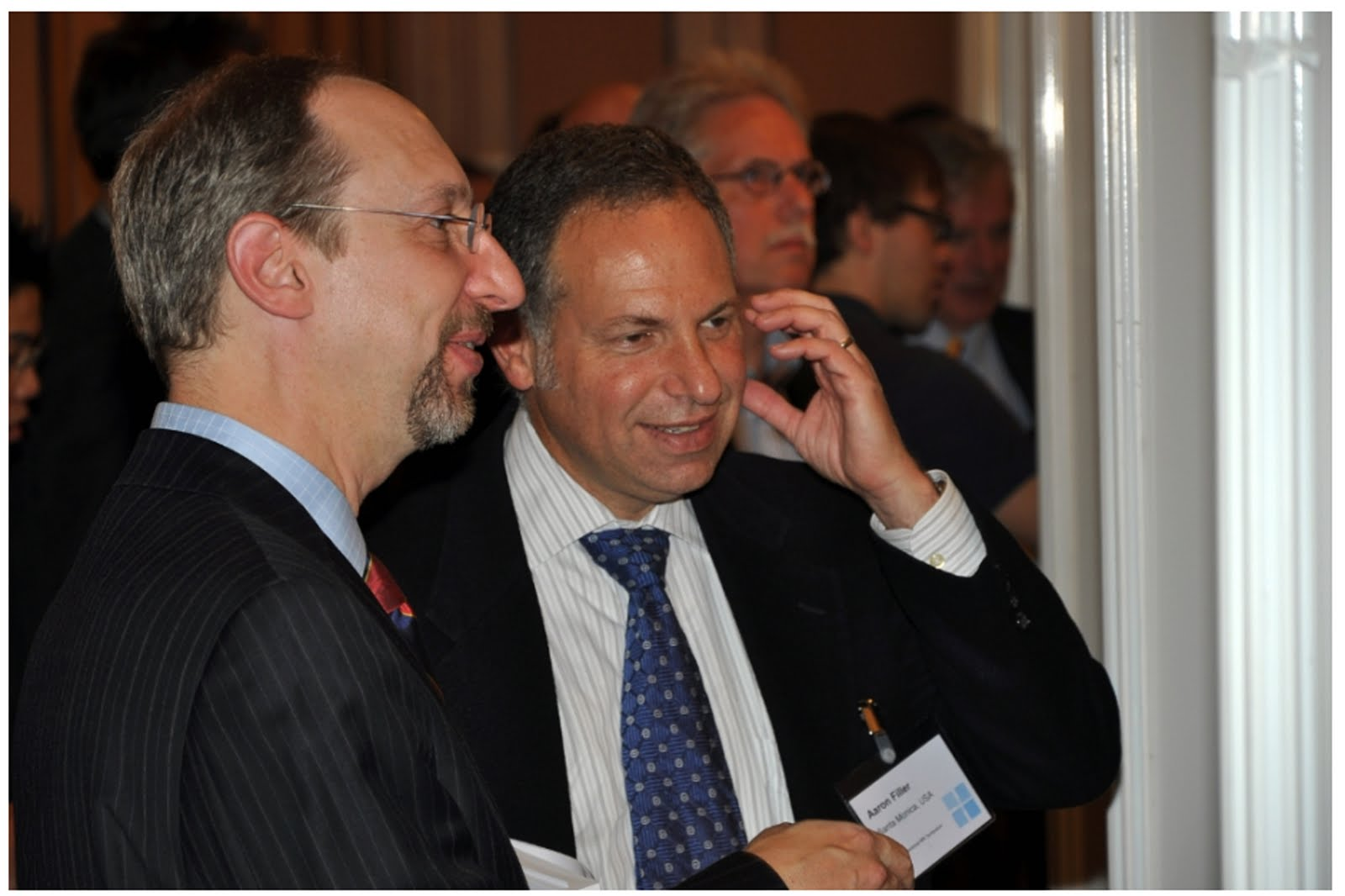 Aaron G. Filler, MD, PhD, FRCS (center) at the Leipzig iMR meeting in September 2010 discussing his work with Jonathan S. Lewin, MD (Left) Chairman of Radiology at Johns Hopkins University and Professor Jens Frahm, PhD (Right) inventor of CHESS and FLASH imaging and Director of the Biomedicine NMR Group at the Max Planck Institute for Biophysical Chemistry.
